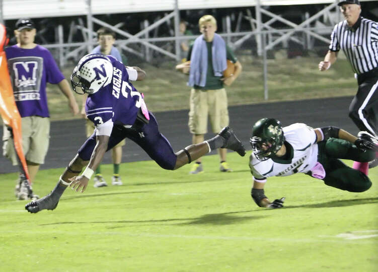 Newton running back Kevin Shorter, No. 3, rushes for a touchdown during the game against East Chambe