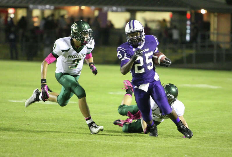 Newton running back Brandon Johnson, 25, rushes during the game against East Chambers Friday at Sing