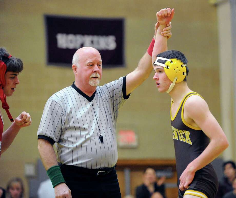 Jimmy Bell, right, of Brunswick, is declared winner over Scott Sutton of Greenwich in 51 seconds in the 126-pound match during boys high school wrestling between Brunswick School and Greenwich High School at Brunswick, Thursday afternoon, Feb. 2, 2012. Brunswick defeated Greenwich, 36-29. Photo: Bob Luckey / Greenwich Time