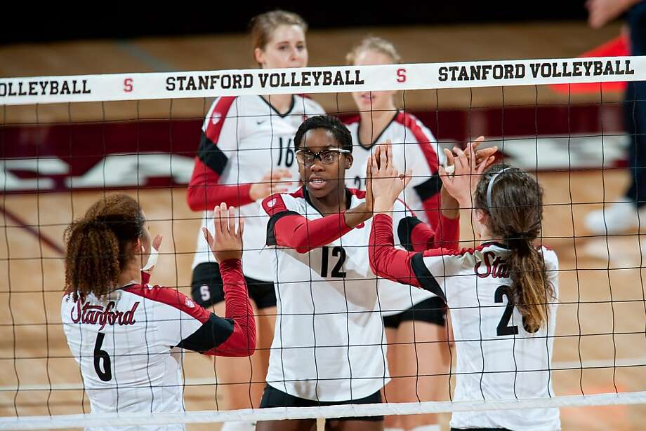 Inky Ajanaku (12) is one of five freshmen at the center of Stanford's volleyball success. Photo: Stanfordvolleyball07, Don Feria