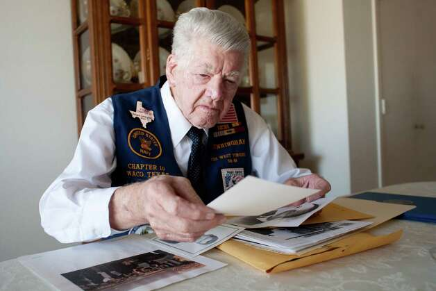 "Richard Cunningham looks through old photographs and maps from his time in the Navy at his home in Hewitt, Texas on December 4, 2012.  Richard Cunningham was a 20-year-old chief boatswainÕs mate stationed on the USS West Virginia when he survived the attack on Pearl Harbor on December 7, 1941. Cunningham, now 91, is photographed at his home in Hewitt, Texas.  Assigned to boat duty that morning, Cunningham was in the middle of the harbor when the attack began. ""It was a black day. The smoke was black, the oil on the water was on fire and that was black.""  Cunningham survived a near miss with a torpedo and returned to the harbor to pull his fellow sailors from the water. ""You'd reach down to the hands coming up out of the water and they'd slip through yours because they were covered in oil and grease, but you reached down to grab them again."" Cunningham estimates he and his boat mate shuttled nearly 100 sailors to the submarine base to relative safety.  Seventy years after the attack that nearly killed him, Cunningham holds no grudges against the Japanese. ""How can I expect God to forgive me if I can't forgive others,"" said Cunningham. ""Some people carry that hate to the grave, but not me."" Photo: Julia Robinson / © Julia Robinson Photo"