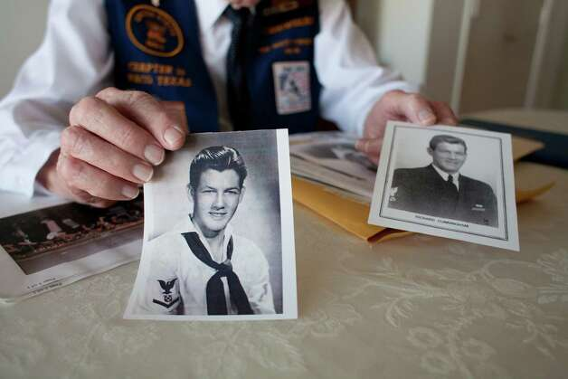 Richard Cunningham holds photographs of himself from his time in the Navy at his home in Hewitt, Texas on December 4, 2012. Photo: Julia Robinson / © Julia Robinson Photo