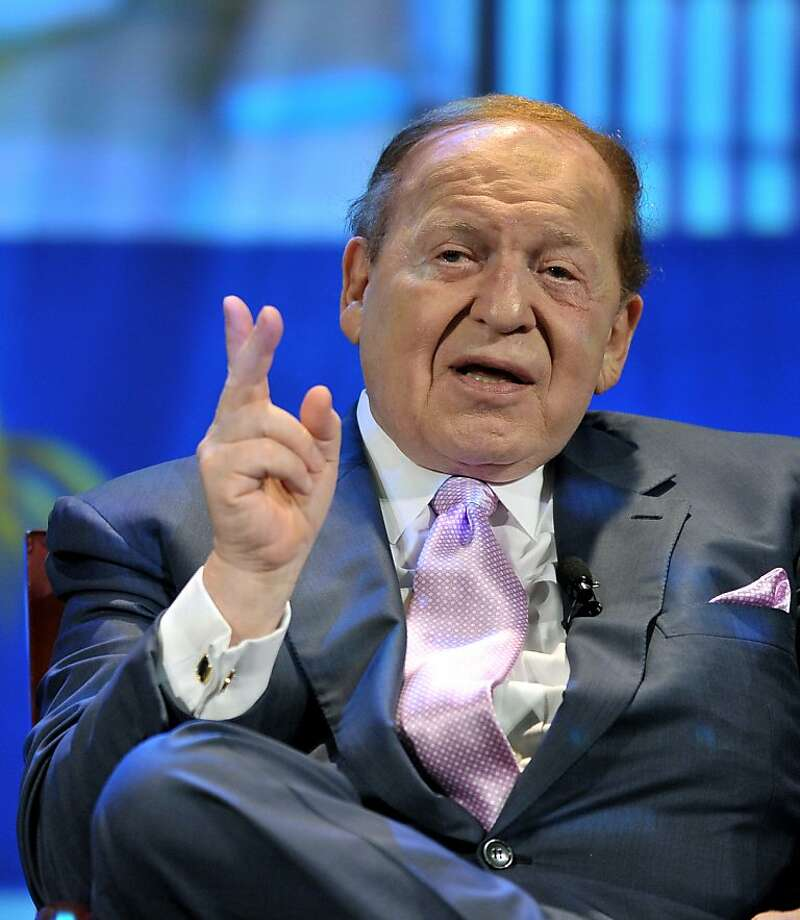 This file picture taken on August 28, 2008 shows chairman and CEO of the Las Vegas Sands Corps., Sheldon Adelson, addressing a press confernce following the opening of the Four Seasons Hotel in Macau.  US gaming tycoon Sheldon Adelson's Macau-based subsidiary Sands China said on August 1, 2012 it was under investigation over the transfer of data from the Chinese territory to the United States.  AFP PHOTO / FILES / MIKE CLARKEMIKE CLARKE/AFP/GettyImages Photo: Mike Clarke, AFP/Getty Images
