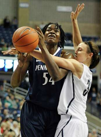 Penn State's Nikki Greene, left, is guarded by Connecticut's Kelly Faris, right, during the first half of an NCAA college basketball game in Storrs, Conn., Thursday, Dec. 6, 2012. (AP Photo/Jessica Hill) Photo: Jessica Hill, Associated Press / FR125654 AP