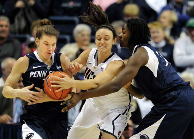 Connecticut's Kelly Faris, center, steals the ball from Penn State's Nikki Greene, right as Greene attempts to pass to Penn State's Maggie Lucas, left, during the first half of an NCAA college basketball game in Storrs, Conn., Thursday, Dec. 6, 2012. (AP Photo/Jessica Hill) Photo: Jessica Hill, Associated Press / FR125654 AP