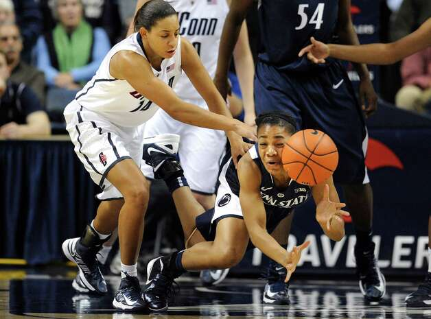 Penn State's Ariel Edwards, right, dives for the ball while pressured by Connecticut's Bria Hartley, left, during the first half of an NCAA college basketball game in Storrs, Conn., Thursday, Dec. 6, 2012. (AP Photo/Jessica Hill) Photo: Jessica Hill, Associated Press / FR125654 AP