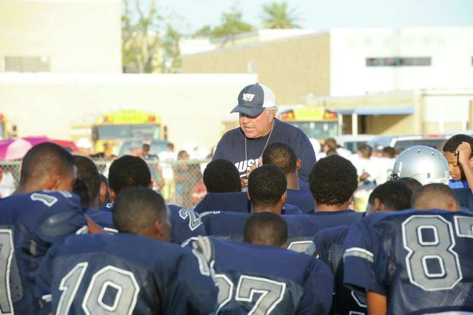 West Orange-Stark head football coach Cornel Thompson talks with his team before the Mustangs scrimmage against Little Cypress-Mauriceville at West Orange-Stark Middle School. Friday,  August 12, 2011 Valentino Mauricio/The Enterprise Photo: Valentino Mauricio