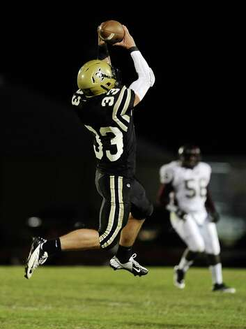 Nederland tight end Korbin Stampley, 33, makes a great catch for another Bulldog first down during the Nederland High School football game against Central High School in Nederland on Friday, November 9, 2012. Photo taken: Randy Edwards/The Enterprise Photo: Randy Edwards