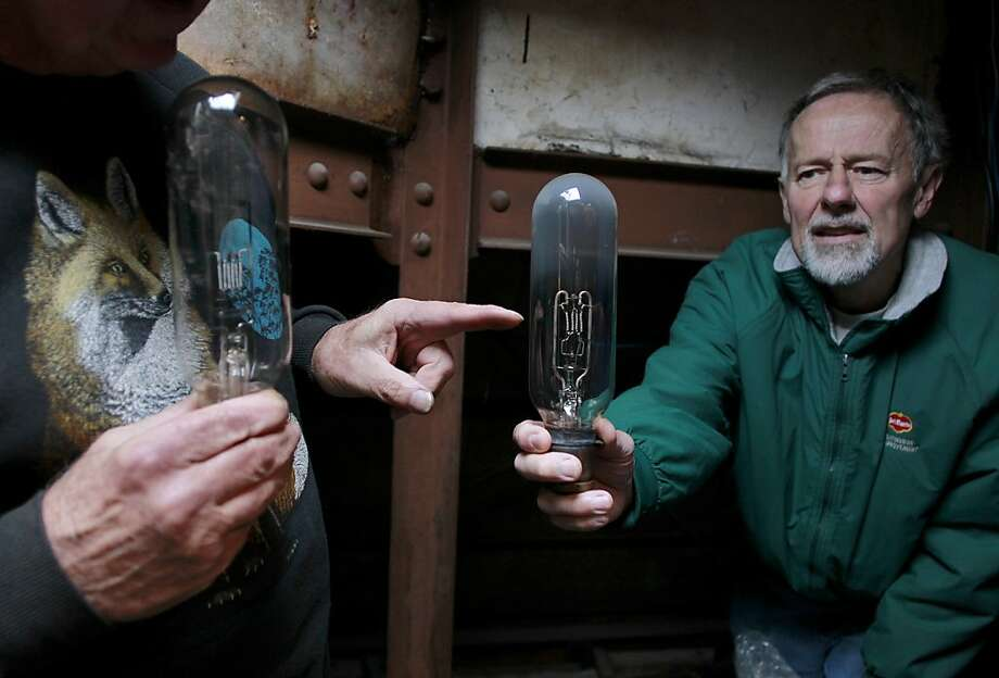 Dick Heron (right) compares old and new projection light bulbs for the historic beacon with Burt Bogardus at Mount Diablo State Park on Thursday, Nov. 29, 2012. Volunteers are preparing for the annual beacon lighting ceremony on Dec. 7. In it's heydey, the beacon emitted a 10 million candlepower beam seen as far as 100 miles away. Photo: Paul Chinn, The Chronicle