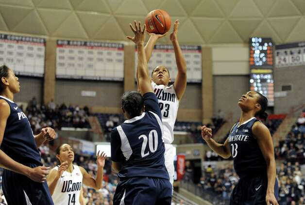Connecticut's Kaleena Mosqueda-Lewis shoots over Penn State's Alex Bentley (20) during the second half of an NCAA college basketball game in Storrs, Conn., Thursday, Dec. 6, 2012. Mosqueda-Lewis was top scorer with 25 total points. Connecticut won 67-52. (AP Photo/Jessica Hill) Photo: Jessica Hill, Associated Press / FR125654 AP
