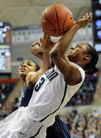 Connecticut's Brianna Banks, right, is fouled by Penn State's Ariel Edwards during the second half of an NCAA college basketball game in Storrs, Conn., Thursday, Dec. 6, 2012.  Connecticut won 67-52. (AP Photo/Jessica Hill) Photo: Jessica Hill, Associated Press / FR125654 AP