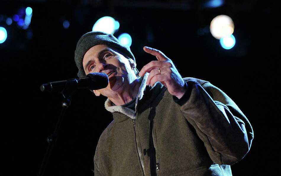 Singer James Taylor performs at a concert during the 90th National Christmas Tree Lighting Ceremony