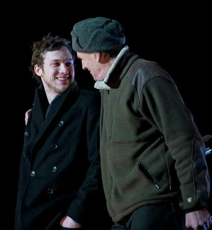 American Idol season 11 winner Phillip Phillips and singer James Taylor participate in the annual National Christmas Tree Lighting on the Ellipse, Thursday, Dec. 6, 2012, in Washington. This year's giant blue spruce is new, transplanted in October on the Ellipse, south of the White House. Photo: Carolyn Kaster, Associated Press / AP