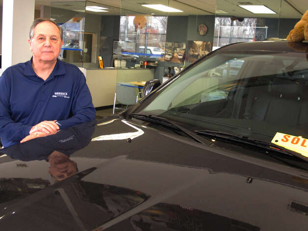 Joe Settineri , owner of Merrick Dodge Chrysler Jeep of Wantagh, N.Y., stands beside a recently sold Jeep. The car dealer says sales have been extraordinary in the weeks since Superstorm Sandy, as thousands of people are trying to replace vehicles damaged in the storm.(AP Photo/Frank Eltman) Photo: Frank Eltman
