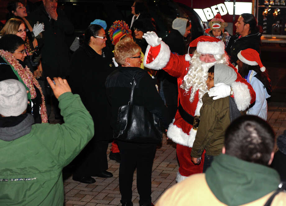 Santa arrives to greet children during the annual Downtown Holiday Tree Lighting at McLevy Green in downtown Bridgeport, Conn. on Thursday December 6, 2012. Photo: Christian Abraham / Connecticut Post