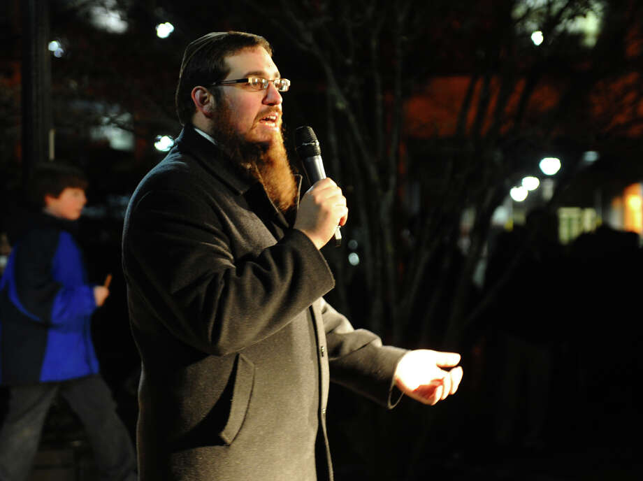 Rabbi Shlame Landa, of Chabad of Fairfield, talks about the lighting of the menorah for Hanukkah at the annual Downtown Holiday Tree Lighting at McLevy Green in downtown Bridgeport, Conn. on Thursday December 6, 2012. Photo: Christian Abraham / Connecticut Post