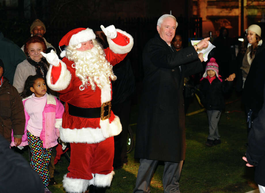 Mayor Bill Finch and Santa Claus get into the swing of things during the annual Downtown Holiday Tree Lighting at McLevy Green in downtown Bridgeport, Conn. on Thursday December 6, 2012. Photo: Christian Abraham / Connecticut Post