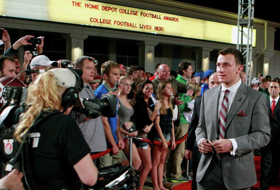 Texas A&M quarterback Johnny Manziel arrives at the Home Depot College Football Awards in Lake Buena Vista, Fla., Thursday, Dec. 6, 2012. (AP Photo/John Raoux) Photo: John Raoux, Associated Press / AP