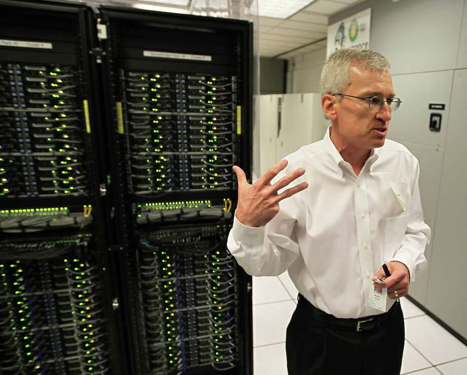 Keith Gray, Manager of High Performance Computing for BP, gives the press a tour of the current HPC (High Performance Computing Center) at BP's North American headquarters Thursday, Dec. 6, 2012, in Houston. BP announced today, that they had begun construction of a new facility in Houston to house the largest supercomputing complex for commercial research in the world.  The new High-Performance Computing (HPC) center, is scheduled to open mid-2013. ( Karen Warren / Houston Chronicle ) Photo: Karen Warren, Staff / © 2012  Houston Chronicle
