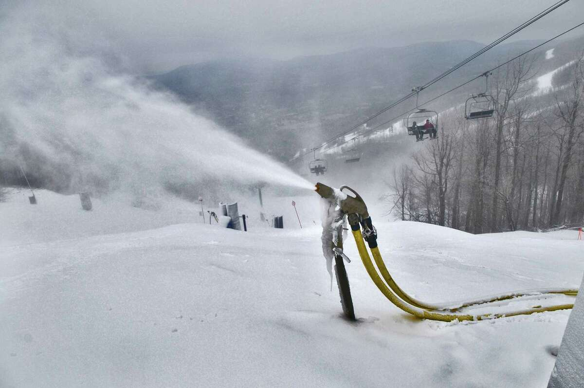 Snow making continues on Windham Mountain as skiers ride the lift on Wednesday Jan. 25, 2012 in Windham, NY. (Philip Kamrass / Times Union archive )