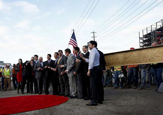 San Francisco 49ers executives have their photo taken before signing a steel beam during the Topping Out ceremony at the new 49ers stadium in Santa Clara, Calif., Thursday, December 6, 2012. Photo: Sarah Rice, Special To The Chronicle