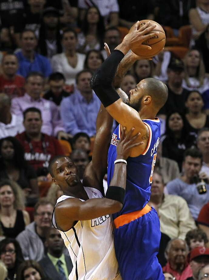 Tyson Chandler (right) goes up for a shot over Miami's Chris Bosh in the Knicks dominating win. Photo: Alan Diaz, Associated Press