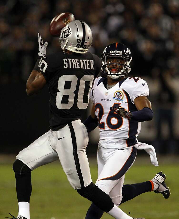 Rod Streater catches a pass past Denver's Rahim Moore for a 58-yard gain in the first quarter. The Oakland Raiders played the Denver Broncos at O.co Coliseum in Oakland, Calif., on Thursday, December 6, 2012. Photo: Carlos Avila Gonzalez, The Chronicle