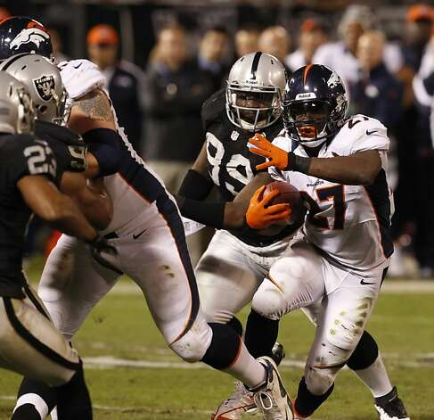 Knowshon Moreno maneuvers through the Raiders' defense. He had 32 carries for 119 yards. Photo: Carlos Avila Gonzalez, The Chronicle