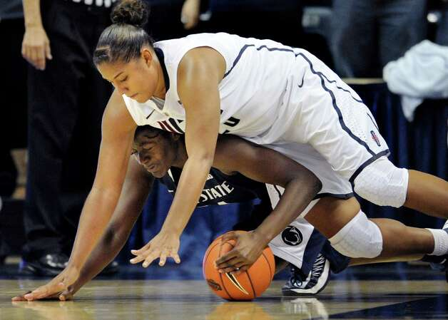 Connecticut's Kaleena Mosqueda-Lewis, top falls on Penn State's Nikki Greene during the second half of an NCAA college basketball game in Storrs, Conn., Thursday, Dec. 6, 2012. Connecticut won 67-52. (AP Photo/Jessica Hill) Photo: Jessica Hill, Associated Press / FR125654 AP