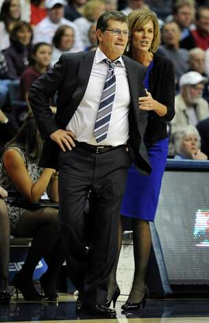 Connecticut head coach Geno Auriemma, left, is held back by associate head coach Chris Dailey during the second half of an NCAA college basketball game against Penn State in Storrs, Conn., Thursday, Dec. 6, 2012. Connecticut won 67-52.  (AP Photo/Jessica Hill) Photo: Jessica Hill, Associated Press / FR125654 AP