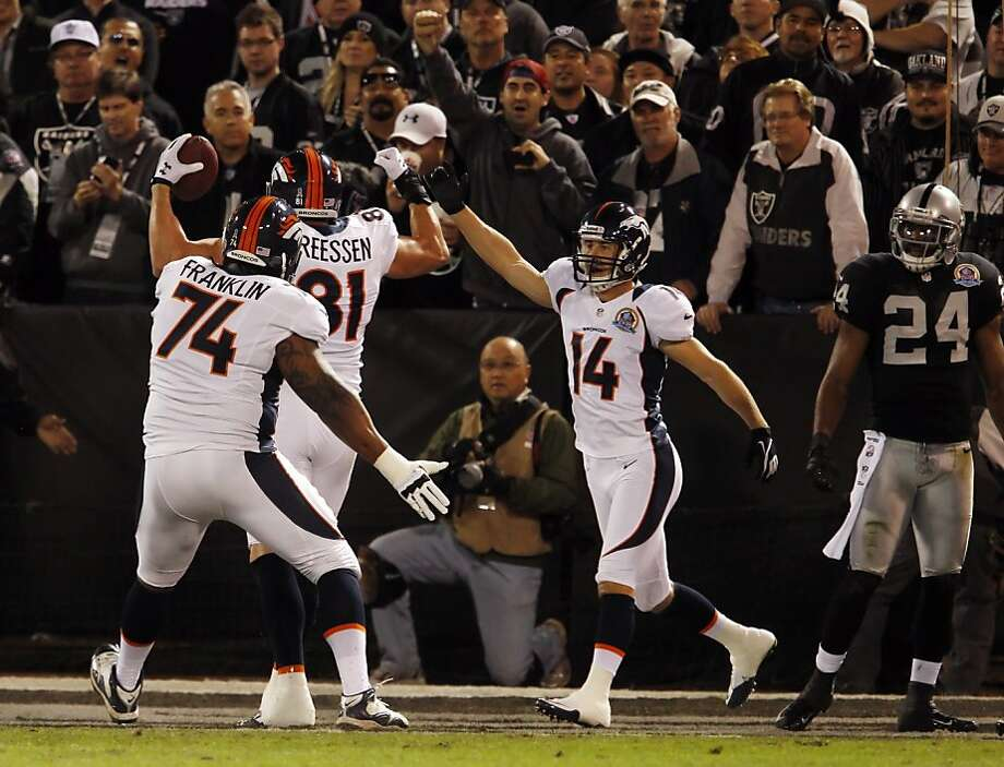 The Broncos celebrate Joel Dreessen's first quarter touchdown. The Oakland Raiders played the Denver Broncos at O.co Coliseum in Oakland, Calif., on Thursday, December 6, 2012. Photo: Carlos Avila Gonzalez, The Chronicle