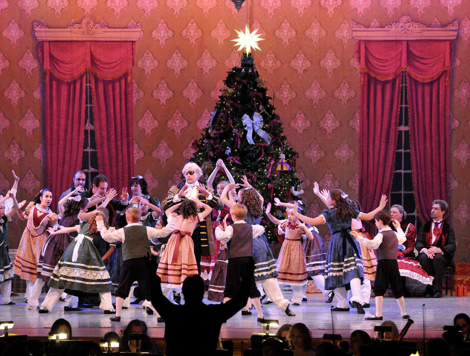 "Children surround Great Uncle Drosselmeyer, wearing eye patch, played by Harald Lund, during the dress rehearsal for Danbury Music Centre's production of ""The Nutcracker Ballet"" at Danbury High School on Thursday, Dec. 6, 2012. Photo: Jason Rearick / The News-Times"