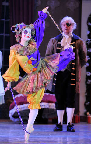 "The Pagliacci Doll, played by Demeri Sutula, left, dances after Great Uncle Drosselmeyer, played by Garald Lund, animated the doll during the dress rehearsal performance of the Danbury Music Centre's ""The Nutcracker Ballet"" at Danbury High School on Thursday, Dec. 6, 2012. Photo: Jason Rearick / The News-Times"