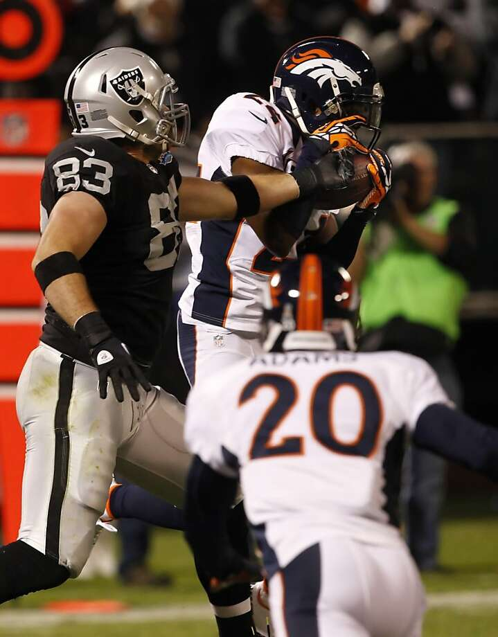 Bronco Champ Bailey's interception of a pass to Brandon Myers (83) adds a hit to the Raiders' lost season. Photo: Carlos Avila Gonzalez, The Chronicle