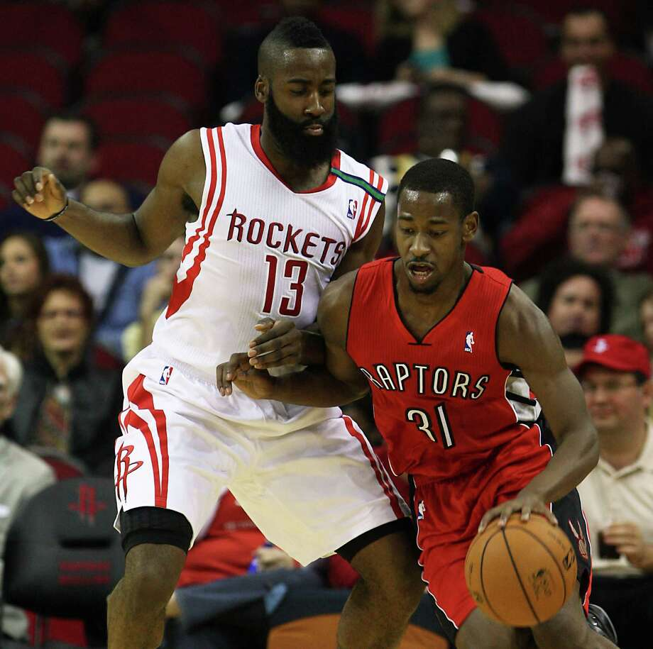 The Houston Rockets James Harden left, and the Toronto Raptors Terrence Ross during the second quarter of NBA game action at the Toyota Center Tuesday, Nov. 27, 2012, in Houston. ( James Nielsen / Chronicle ) Photo: James Nielsen, Staff / © Houston Chronicle 2012