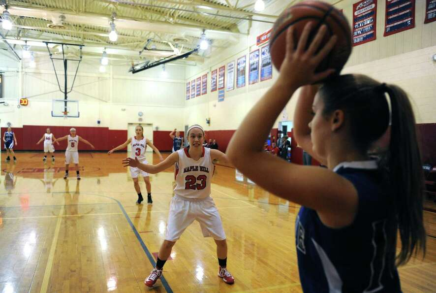 Maple Hill Wildcats Lindsay Mannion guards the line on a inbounds play during their girl's high scho