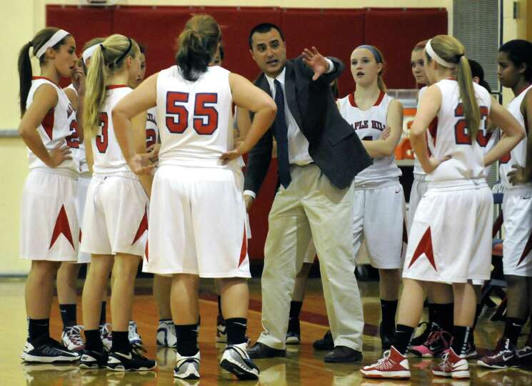 Maple Hill Wildcats coach Mark Bubniak talks with his team during their girl's high school basketbal