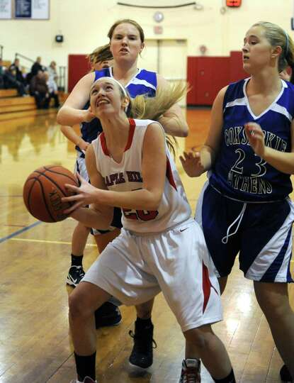 Maple Hill Wildcats Lindsay Mannion fights to the basket during their girl's high school basketball