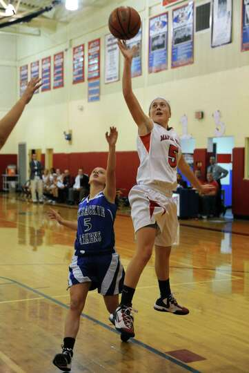 Maple Hill Wildcats Anna Despart goes to the basket during their girl's high school basketball game
