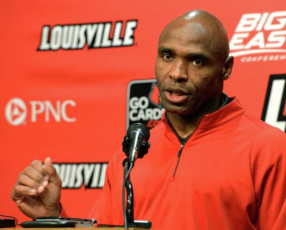 Louisville head football coach Charlie Strong speaks with reporters Thursday, Dec. 6, 2012, in Louisville, Ky. Strong announced this morning that he has turned down the head coaching job offer from the University of Tennessee and will stay at Louisville. (AP Photo/Timothy D. Easley) Photo: Timothy D. Easley