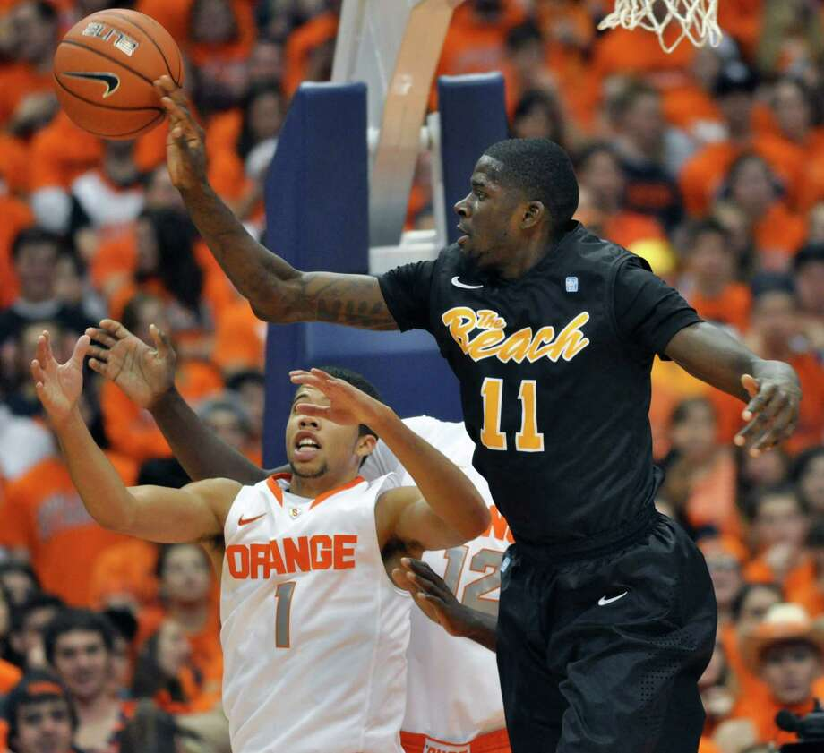 Long Beach State's James Ennis, right, loses control of the ball in front of Syracuse's Michael Carter-Williams during the first half of an NCAA college basketball game in Syracuse, N.Y., Thursday, Dec. 6, 2012. (AP Photo/Kevin Rivoli) Photo: KEVIN RIVOLI