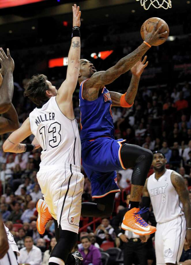 New York Knicks' J.R. Smith (8) goes to the basket as Miami Heat's Mike Miller (13) defends in the second half of an NBA basketball game, Thursday, Dec, 6, 2012, in Miami. The Knicks won 112-92. ( AP Photo/Alan Diaz) Photo: Alan Diaz
