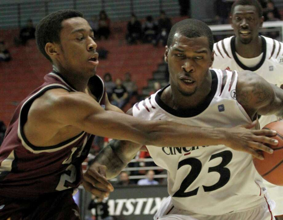 Cincinnati Sean Kilpatrick drives past Arkansas Little Rocks' John Gillon in the second half of their NCAA college basketball game in Cincinnati Thursday Dec. 6, 2012. Cincinnati won 87-53. AP Photo/Tom Uhlman) Photo: TOM UHLMAN