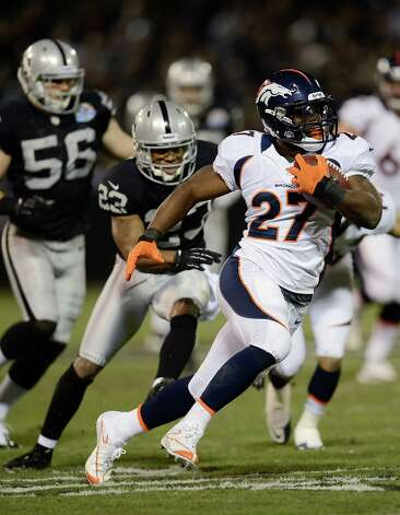 OAKLAND, CA - DECEMBER 06:  Knowshon Moreno #27 of the Denver Broncos gains 26 yards on a short reception against the Oakland Raiders in the first quarter at Oakland-Alameda County Coliseum on December 6, 2012 in Oakland, California.  (Photo by Thearon W. Henderson/Getty Images) Photo: Thearon W. Henderson / 2012 Getty Images