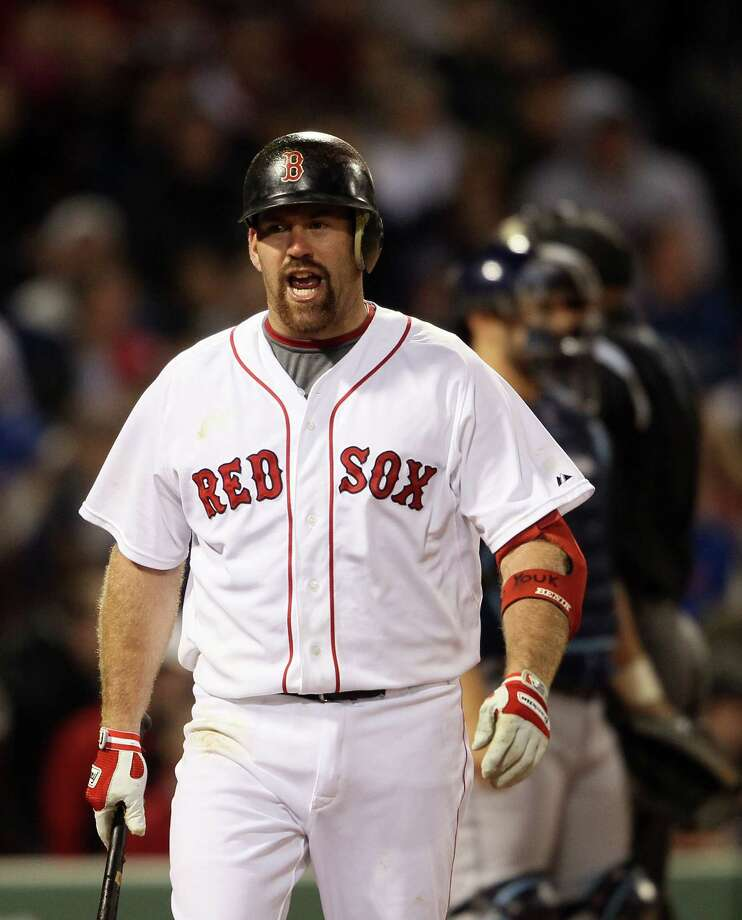 BOSTON, MA - APRIL 12:  Kevin Youkilis #20 of the Boston Red Sox reacts to his strikeout in the sixth inning against the Tampa Bay Rays on April 12, 2011 at Fenway Park in Boston, Massachusetts.  (Photo by Elsa/Getty Images) Photo: Elsa / 2011 Getty Images