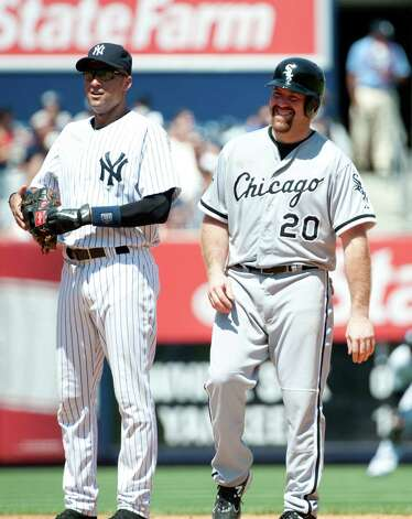 New York Yankees shortstop Derek Jeter (2) and Chicago White Sox third baseman Kevin Youkilis (20) at Yankee Stadium (Andrew Theodorakis/New York Daily News). Photo: Andrew Theodorakis / New York Daily News