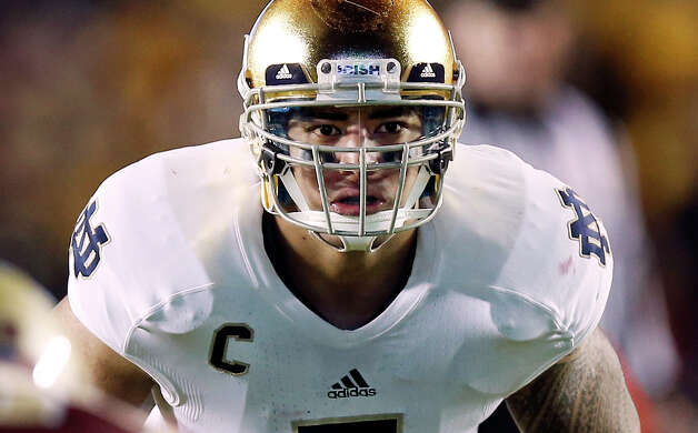 FILE - In this Nov. 10, 2012, file photo, Notre Dame linebacker Manti Te'o waits for the snap during the second half of Notre Dame's 21-6 win over Boston College in a NCAA college football game in Boston. Te'o is a finalist for the Heisman Trophy. (AP Photo/Winslow Townson, File) Photo: Winslow Townson