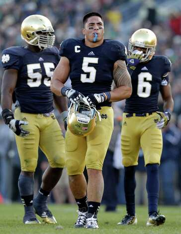 FILE - In this Nov. 17, 2012, file photo, Notre Dame linebacker Manti Te'o walks off the field during the first half of an NCAA college football game against Wake Forest in South Bend, Ind. Te'o is a finalist for the Heisman Trophy. (AP Photo/Michael Conroy, File ) Photo: Michael Conroy
