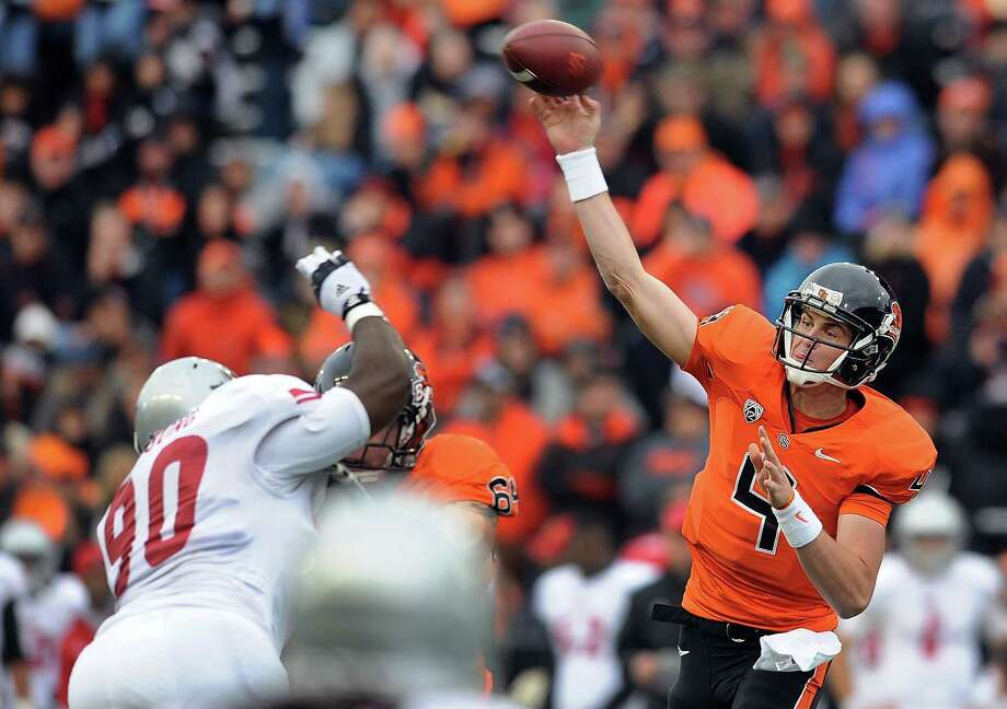Quarterback Sean Mannion #4 of the Oregon State Beavers passes the ball as defensive lineman Lorenza Young #90 of the Nicholls State Colonels applies pressure in the second quarter of the game on December 1, 2012 at Reser Stadium in Corvallis, Oregon. Photo: Steve Dykes, Getty Images / 2012 Getty Images