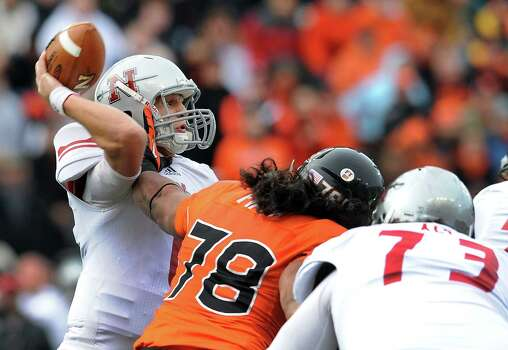 Quarterback Landry Klann #6 of the Nicholls State Colonels passes the ball as defensive end Rudolf Fifita #78 of the Oregon State Beavers applies pressure in the first quarter of the game on December 1, 2012 at Reser Stadium in Corvallis, Oregon. Photo: Steve Dykes, Getty Images / 2012 Getty Images